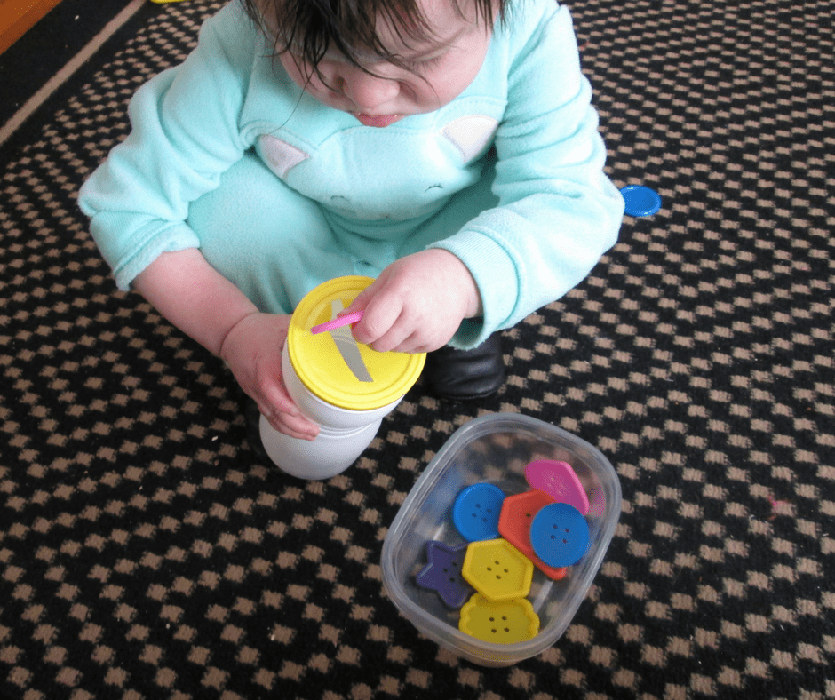 This easy DIY button game for babies also encourages fine motor skills.