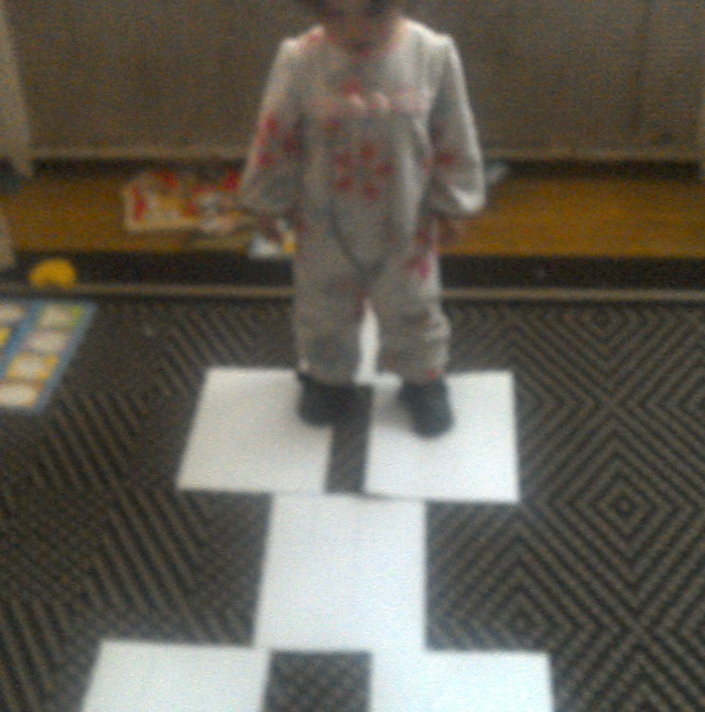Squeaker tries out the indoor hopscotch board