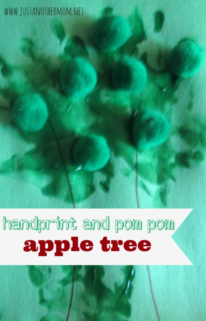 We had so much fun making this handprint and pom pom apple tree! My toddler really loved getting into the fingerpaint.
