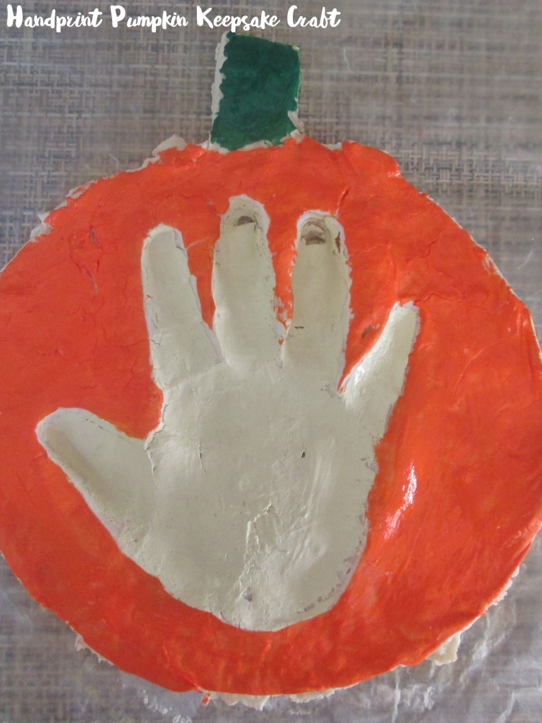 Celebrate Fall and preserve memories with this easy handprint pumpkin keepsake craft.