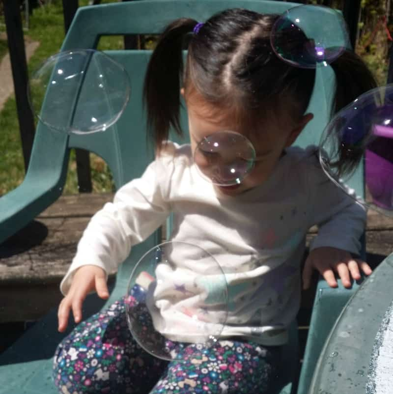 squeaker outside with bubbles
