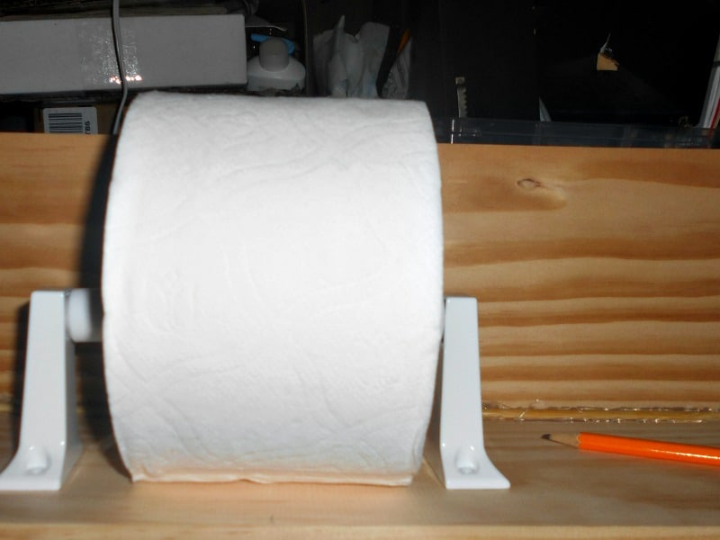 measuring the placement for the diy toilet paper holder
